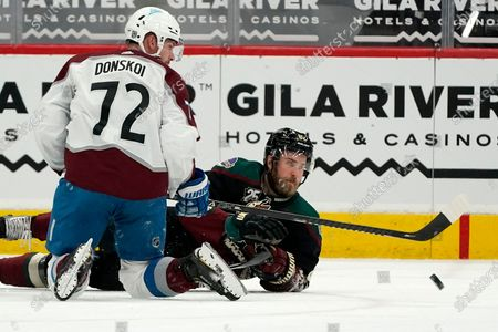 Stock Picture of Colorado Avalanche right wing Joonas Donskoi (72) has his pass knocked away by Arizona Coyotes defenseman Jordan Oesterle, right, during the third period of an NHL hockey game, in Glendale, Ariz. The Avalanche won 3-2