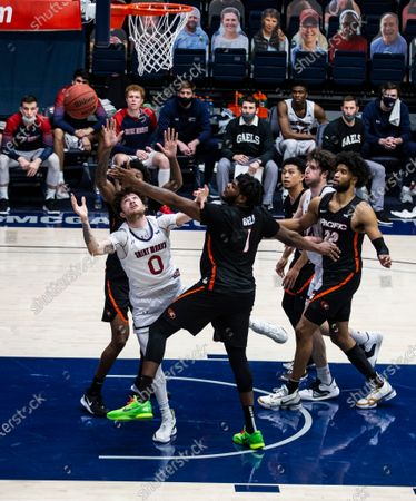 Stock Image of Moraga CA, U.S.A. St. Mary's guard Logan Johnson (0) battle for the rebound during the NCAA Men's Basketball game between Pacific Tigers and the Saint Mary's Gaels 58-46 win at McKeon Pavilion Moraga Calif. Thurman James / CSM