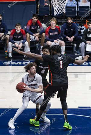 Moraga CA, U.S.A. St. Mary's guard Logan Johnson (0) tries to score in the paint during the NCAA Men's Basketball game between Pacific Tigers and the Saint Mary's Gaels 58-46 win at McKeon Pavilion Moraga Calif. Thurman James / CSM