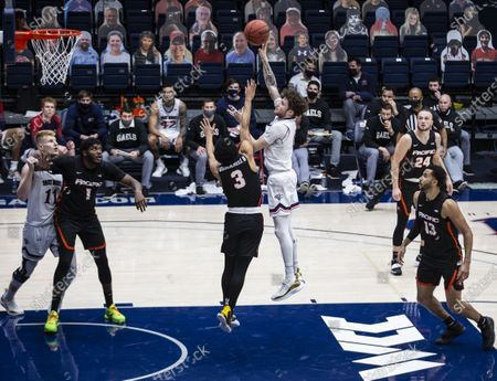 Stock Picture of Moraga CA, U.S.A. St. Mary's guard Logan Johnson (0) shoots the ball in the paint during the NCAA Men's Basketball game between Pacific Tigers and the Saint Mary's Gaels 58-46 win at McKeon Pavilion Moraga Calif. Thurman James / CSM