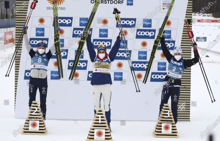 First place Norway's Therese Johaug, center, celebrates on the podium with second place Sweden's Frida Karlsson, left, and third place Sweden's Ebba Andersson during the WSC Women's Skiathlon 15km cross country event at the FIS Nordic World Ski Championships in Oberstdorf, Germany