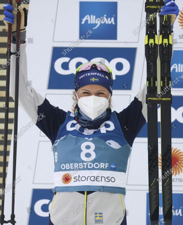 Sweden's Frida Karlsson celebrates on the podium after taking second place in the WSC Women's Skiathlon 15km cross country event at the FIS Nordic World Ski Championships in Oberstdorf, Germany