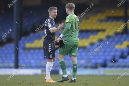 (L-R) Jason Demetriou and Harry Seaden of Southend United after the Sky Bet League Two match between Southend United and Salford City at Roots Hall in Southend - 27th February 2021