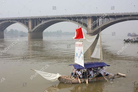 Xia Yu and his volunteer crew set sail on the plastic bottle boat enroute to Shanghai 1,500km away. China.