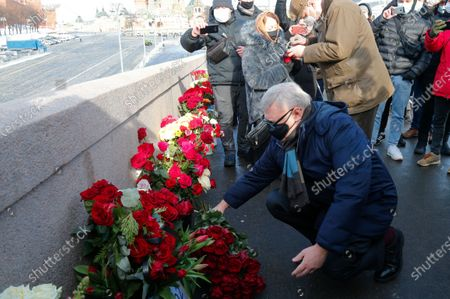 Former Russian Prime Minister Mikhail Kasyanov lays flowers near the place where Russian opposition leader Boris Nemtsov was gunned down, in Moscow, Russia, . People gathered on a central Moscow boulevard Saturday in remembrance of a Russian opposition leader who was gunned down six years ago while walking on a bridge adjacent to the Kremlin