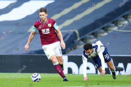 James Tarkowski of Burnley shrugs off a challenge from Dele Alli of Tottenham Hotspur; Tottenham Hotspur Stadium, London, England; English Premier League Football, Tottenham Hotspur versus Burnley.