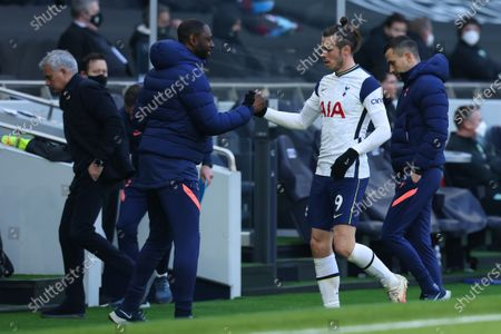 Gareth Bale of Tottenham Hotspur shakes hands with Ledley King after he is substituted; Tottenham Hotspur Stadium, London, England; English Premier League Football, Tottenham Hotspur versus Burnley.