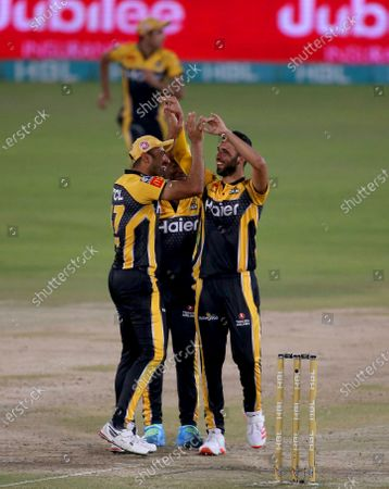 Stock Picture of Peshawar Zalmi' Saqib Mahmood, right, celebrates with teammate Wahab Riaz after taking the wicket of Islamabad United' Alex Hales during a Pakistan Super League T20 cricket match between Islamabad United and Peshawar Zalmi at the National Stadium, in Karachi, Pakistan