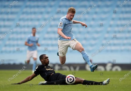 Manchester City's Kevin De Bruyne, top, duels for the ball with West Ham's Issa Diop during the English Premier League soccer match between Manchester City and West Ham United at the Etihad stadium in Manchester, England