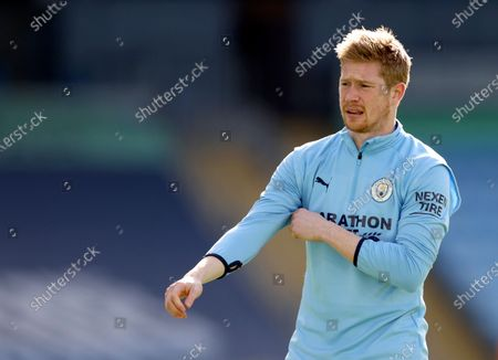 Manchester City's Kevin De Bruyne looks on during warm up before the English Premier League soccer match between Manchester City and West Ham United at the Etihad stadium in Manchester, England