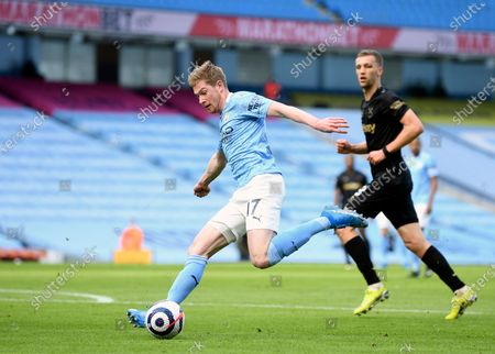 Manchester City's Kevin De Bruyne kicks the ball during the English Premier League soccer match between Manchester City and West Ham United at the Etihad stadium in Manchester, England