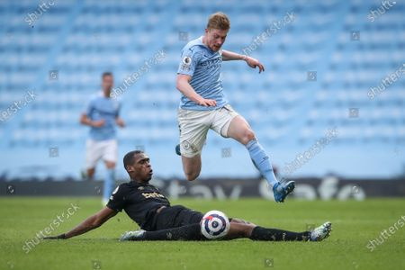 Kevin De Bruyne (top) of Manchester City in action against Issa Diop (bottom) of West Ham during the English Premier League soccer match between Manchester City and West Ham United in Manchester, Britain, 27 February 2021.