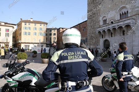 Local police carry out checks following a mayoral anti-gathering ordinance in Brescia, northern Italy, 27 February 2021. The mayor of Brescia, Emilio Del Bono, signed an order to close the main parks of the city for the weekend to stem Covid-19 infections. In addition, the mayor intervened on the consumption of food and drinks on the grounds public of parks, squares, and gardens, prohibiting it on Saturdays and Sundays.