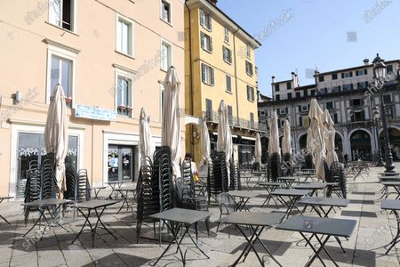 Bars and restaurants remain empty following a mayoral anti-gathering ordinance in Brescia, northern Italy, 27 February 2021. The mayor of Brescia, Emilio Del Bono, signed an order to close the main parks of the city for the weekend to stem Covid-19 infections. In addition, the mayor intervened on the consumption of food and drinks on the grounds public of parks, squares, and gardens, prohibiting it on Saturdays and Sundays.