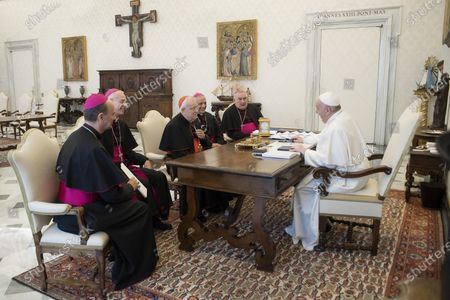 A handout picture provided by the Vatican broadcaster Vatican Media shows Pope Francis (R) receives the board of the Italian Episcopal Conference (CEI), Vatican City, 27 February 2021. The audience was attended by the President of the CEI, Card. Gualtiero Bassetti, Archbishop of Perugia-Citta della Pieve); the vice presidents Mgr. Franco Giulio Brambilla, Bishop of Novara, Mons. Mario Meini, Bishop of Fiesole, and Mons. Antonino Raspanti, bishop of Acireale; the secretary general, Msgr. Stefano Russo, bishop emeritus of Fabriano-Matelica.