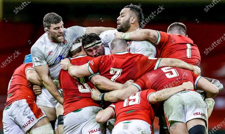 Wales vs England. England's George Martin, Jamie George and Billy Vunipola in a maul