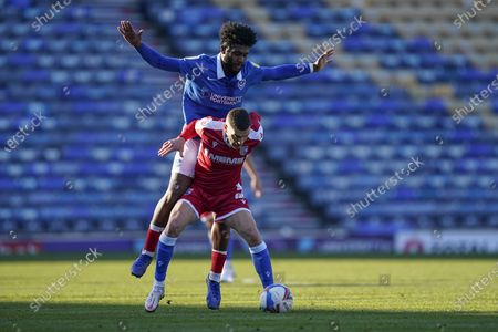 Stuart O'Keefe of Gillingham holds Ellis Harrison of Portsmouth off the ball during the EFL Sky Bet League 1 match between Portsmouth and Gillingham at Fratton Park, Portsmouth