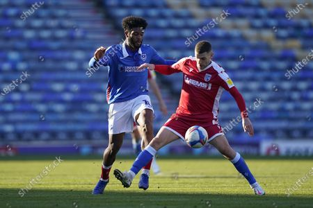 Ellis Harrison of Portsmouth tackles Stuart O'Keefe of Gillingham during the EFL Sky Bet League 1 match between Portsmouth and Gillingham at Fratton Park, Portsmouth