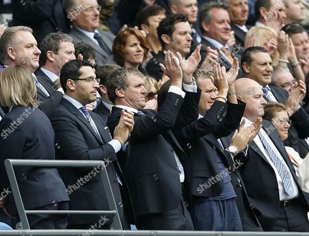 Manchester City chairman Khaldoon Al Mubarak (2nd l) and chief executive Garry Cook (3rd l)  applaud the players at the end of the game