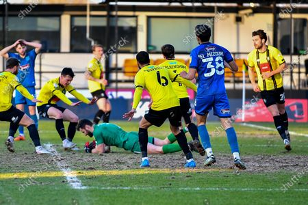 James Belshaw (1) of Harrogate Town gathers the ball as Idris El Mizouni (38) of Grimsby Town looks on during the EFL Sky Bet League 2 match between Harrogate Town and Grimsby Town FC at the EnviroVent Stadium, Harrogate