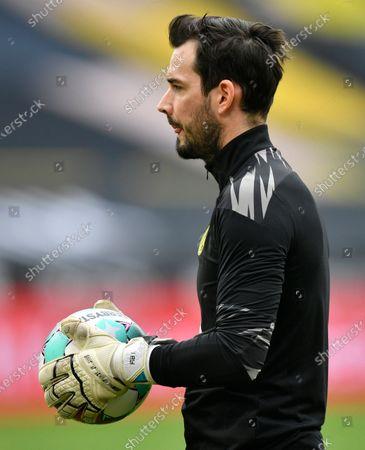 Dortmund's goalkeeper Roman Buerki warms up prior to the start of the German Bundesliga soccer match between Borussia Dortmund and Arminia Bielefeld in Dortmund, Germany