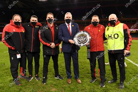Stock Image of Wales coaches Gareth Williams, Stephen Jones, Gethin Jenkins, Wayne Pivac, Jonathan Humphreys and Neil Jenkins celebrate with the triple crown.