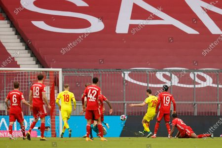Cologne's Ellyes Skhiri scores a goal during the German Bundesliga soccer match between Bayern Munich and 1. FC Koeln in Munich, Germany, 27 February 2021.