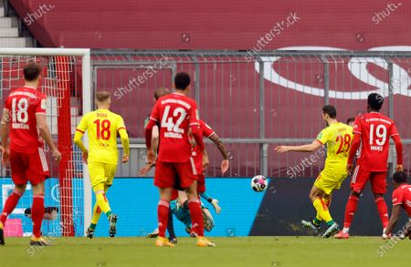 Cologne's Ellyes Skhiri (2R) scores a goal during the German Bundesliga soccer match between Bayern Munich and 1. FC Koeln in Munich, Germany, 27 February 2021.