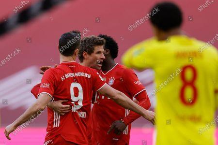 Bayern's Robert Lewandowski (L) celebrates with Bayern's Thomas Mueller (R) after scoring a goal during the German Bundesliga soccer match between Bayern Munich and 1. FC Koeln in Munich, Germany, 27 February 2021.