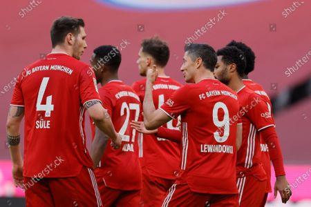 Bayern's Robert Lewandowski celebrates with team mates after scoring a goal during the German Bundesliga soccer match between Bayern Munich and 1. FC Koeln in Munich, Germany, 27 February 2021.