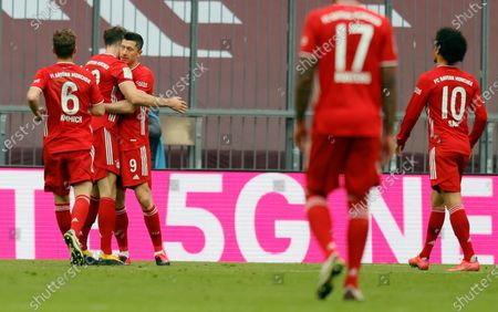 Bayern's Robert Lewandowski (3L) celebrates with team mates after scoring a goal during the German Bundesliga soccer match between Bayern Munich and 1. FC Koeln in Munich, Germany, 27 February 2021.