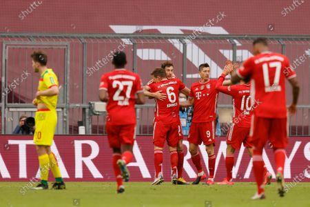 Bayern's Robert Lewandowski (3R) celebrates with team mates after scoring a goal during the German Bundesliga soccer match between Bayern Munich and 1. FC Koeln in Munich, Germany, 27 February 2021.