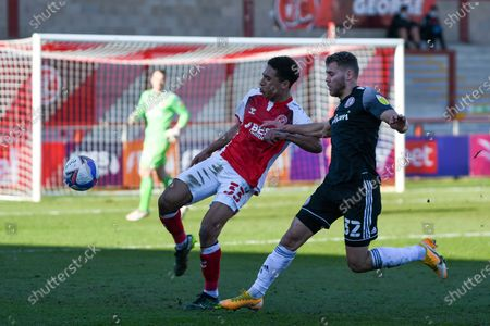 Accrington Stanley's midfielder Dion Charles (32) and Fleetwood Town's defender James Hill (33) challenge for the ball during the EFL Sky Bet League 1 match between Fleetwood Town and Accrington Stanley at the Highbury Stadium, Fleetwood