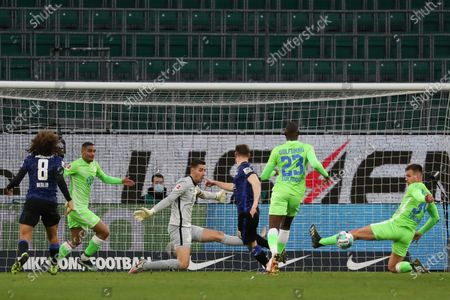 Wolfsburg's goalkeeper Koen Casteels (3-L) in action during the German Bundesliga soccer match between VfL Wolfsburg and Hertha BSC in Wolfsburg, Germany, 27 February 2021.