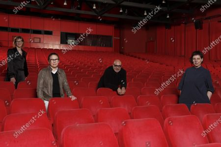 Four members of the Jury of the International Berlin Film Festival Berlinale, Jasmila Zbanic, Ildiko Enyedi, Gianfranco Rosi and Adina Pintilie, from left, pose for a group photo in the empty Berlinale Palace, the main screening theatre of the festival in Berlin, Germany, . The jury will announce the awards of this year's festival on March 5, 2021. The other two members of the jury Mohammad Rasoulof and Nadav Lapid cannot attend in person the jury meetings in Berlin