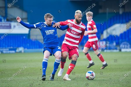 Stock Image of Doncaster midfielder John Bostock (15) controls the ball as Ipswich Town forward Freddie Sears (20) tries to win it back during the EFL Sky Bet League 1 match between Ipswich Town and Doncaster Rovers at Portman Road, Ipswich