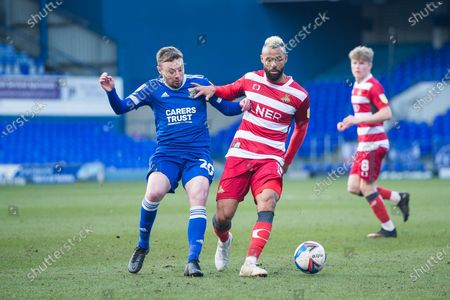 Doncaster midfielder John Bostock (15) controls the ball as Ipswich Town forward Freddie Sears (20) tries to win it back during the EFL Sky Bet League 1 match between Ipswich Town and Doncaster Rovers at Portman Road, Ipswich