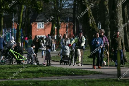 People walk through Alexandra Park on a glorious Saturday afternoon.