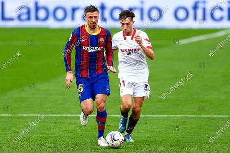 Munir El Haddadi of Sevilla FC and Clement Lenglet of FC Barcelona