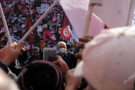"Rached Ghannouchi, President of Ennahdha party and the Speaker of the Tunisian party gesture in front of the crowd. The protest was the biggest demonstration in Tunisia for years, and party faithful bussed in from across the country chanted ""the people want to protect institutions"" and ""the people want national unity"" as they marched in the centre of Tunis."