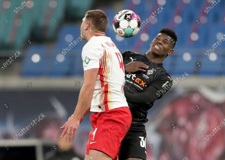 Leipzig's Willi Orban, left, and Moenchengladbach's Breel Embolo, right, go for a header during the German Bundesliga soccer match between RB Leipzig and Borussia Moenchengladbach in Leipzig, Germany
