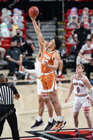 Texas' Kai Jones (22) and Texas Tech's Marcus Santos-Silva (14) go up for the tipoff during the first half of an NCAA college basketball game in Lubbock, Texas