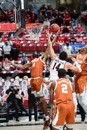 Texas' Greg Brown (4) blocks a shot from Texas Tech's Marcus Santos-Silva (14) during the second half of an NCAA college basketball game in Lubbock, Texas