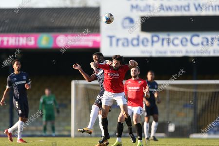 Jason Lowe of Salford City and Nathan Ferguson of Southend United challenge for a header