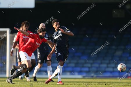 Stock Photo of Timothee Dieng of Southend United passes the ball uner pressure from Jason Lowe of Salford City