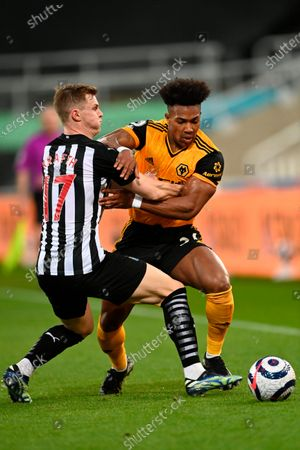 Wolverhampton's Adama Traore (R) in action against Newcastle's Emil Krafth (L) during the English Premier League soccer match between Newcastle United and Wolverhampton Wanderers in Newcastle, Britain, 27 February 2021.