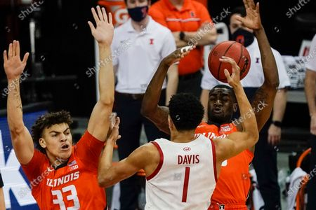 Wisconsin's Jonathan Davis runs into Illinois's Da'Monte Williams and Coleman Hawkins (33) during the first half of an NCAA college basketball game, in Madison, Wis