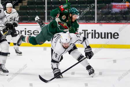 Stock Photo of Minnesota Wild right wing Ryan Hartman (38) is cut off from the puck by Los Angels Kings defenseman Drew Doughty (8) in the first period during an NHL hockey game, in St. Paul, Minn