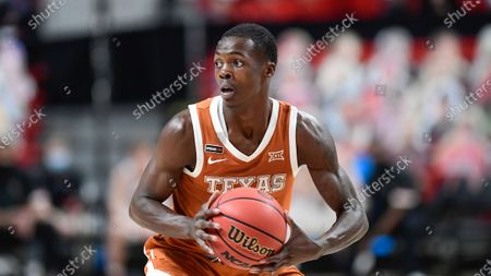 Texas' Andrew Jones (1) controls the ball during the second half of an NCAA college basketball game against Texas Tech in Lubbock, Texas