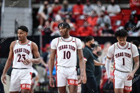 Texas Tech's Chibuzo Agbo (23), Tyreek Smith (10) and Terrence Shannon Jr. (1) walk back after a timeout during the second half of an NCAA college basketball game against Texas in Lubbock, Texas